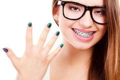 Happy nerdy teenage with brace wearing eyeglasses Royalty Free Stock Photo