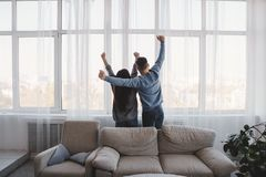 Happy new flat owners looking through the window stock image