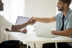Happy new multiracial diverse partners shaking hands starting bu Royalty Free Stock Images