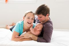 Happy new parents with their newborn son Stock Image