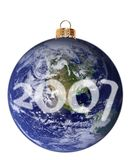 Happy New Planet 2007. Isolated Christmas ornament in the shape of planet Earth with the New Year 2007 written across the clouds. Image of planet Earth is stock illustration