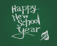 Happy new school year. Vector chalk text on green blackboard. Royalty Free Stock Image