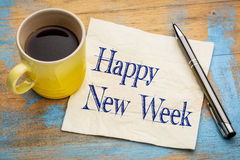 Happy New Week on napkin. Happy New Week - cheerful handwriting on a napkin with a cup of coffee stock image