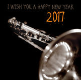Happy new year 2017 – a greeting card. Happy new year 2017 – a greeting card with a music instrument Royalty Free Stock Images