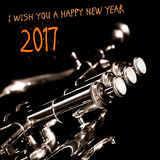 Happy new year 2017 – a greeting card. Happy new year 2017 – a greeting card with a music instrument Royalty Free Stock Image