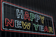 Happy new year. It represents a building with a neon sign that says happy new year Royalty Free Stock Image