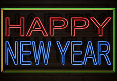 Happy New Year. It represents a building with a neon sign that says happy new year Royalty Free Stock Images