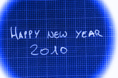 Happy New Year 2010. Handwritten in white on blue text against a matrix or grid background Royalty Free Stock Photography