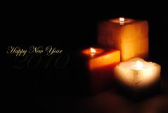 Happy New Year 2010. Three candles. Peace and love for this 210 year Royalty Free Stock Photo
