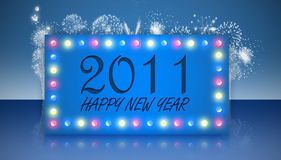 Happy new year 2011. Greeting card on a shiny surface with fireworks in the background Stock Photography