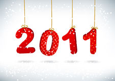 Happy New Year 2011 greeting card. Merry letters are suspended on golden filaments Stock Photo