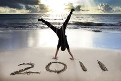 Happy New Year 2011 On Beach Of Sunrise Stock Photos