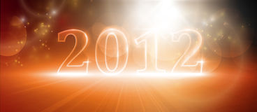 Happy new year 2012. Transparent number 2012. Various light effects giving it a glow in warm shades of red and orange. EPS10 Royalty Free Stock Images