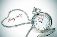 Happy new year 2012. Sentence happy new year and a pocket watch number 2012 inside it Stock Image