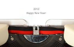 Happy New Year 2012. Typewriter writing Happy New Year 2012 on white background Royalty Free Stock Photo