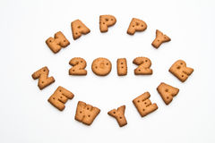Happy New Year 2012 Biscuits. Happy New Year  2012 greeting words made by brown biscuits in center of white surface in landscape orientation for background use Stock Images