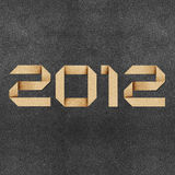 Happy new year 2012  Recycled Paper Craft Stock Image