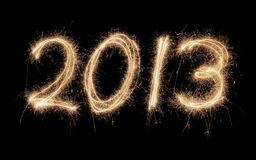 Happy New Year 2013. Number 2013 written with real sparklers on black background stock images