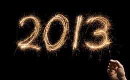 Happy New Year 2013. Year number 2013 written with a sparkler Royalty Free Stock Photos
