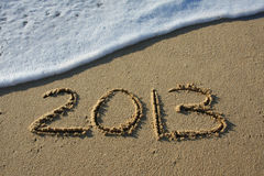 Happy New Year 2013. 2013 written in the sand stock photo