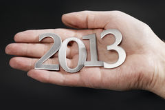 Happy New year 2013. Man holding metallic numbersfor year 2013 in his hand Stock Photo