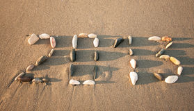 Happy New Year 2013!. 2013 drawn with small stones on the beach Royalty Free Stock Images