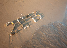 Happy New Year 2013!. 2013 drawn with small stones on the beach Royalty Free Stock Image
