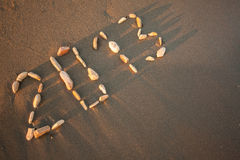 Happy New Year 2013!. 2013 drawn with small stones on the beach Royalty Free Stock Photos