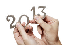 Happy New Year 2013. Man holding metallic number 2013 in his hands Royalty Free Stock Photography