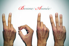 Happy new year 2013 in french. Bonne annee, happy new year written in french, with hands forming number 2013 Stock Image