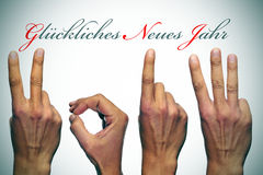 Happy new year 2013 in german. Gluckliches neues jahr, happy new year written in german, with hands forming number 2013 Royalty Free Stock Photo