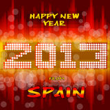 Happy New Year 2013 from Spain. Happy new year's eve with a multicolored background, bright text like little light ball and the colors of the spanish flag Stock Image
