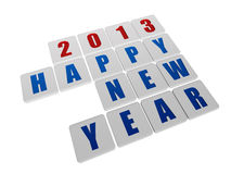 Happy new year 2013 in white tablets. Text happy new year 2013 in 3d white tablets with blue and red figures like ciphers and letters Royalty Free Stock Images
