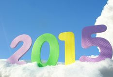 Happy New Year 2015 digits. Colorful Year 2015 digits on the snow stock image