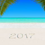 Happy New Year 2017 On Sandy Ocean Tropical Palm Beach Royalty Free Stock Images