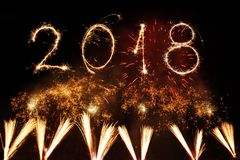 Happy New Year 2018 Written With Sparkle Firework On Black Backg