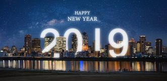 Free Happy New Year 2019 In The City. Panoramic City At Night With Starry Sky And Happy New Year 2019 Celebration Stock Image - 132524991
