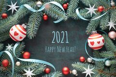 Free Happy New Year 2021. Frame Made With Fir Twigs, Trinkets In Red And Silver, Stars And Ribbons. Royalty Free Stock Photos - 197576388