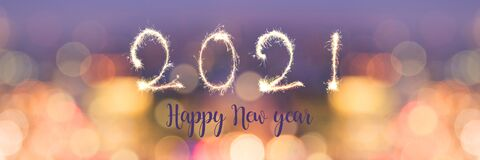 Free Happy New Year 2021 Written With Sparkles On Panoramic Banner Of Blurred Bokeh Holiday Lights Stock Photography - 200003752