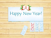 Happy New Year. Message with years from 2011 to 2014 over wooden background Royalty Free Stock Photos