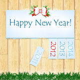 Happy New Year. Message with years from 2011 to 2014 over wooden background Royalty Free Stock Photo