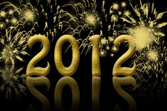 Happy New Year. The year 2012 in gold with fireworks in the background Royalty Free Stock Photos