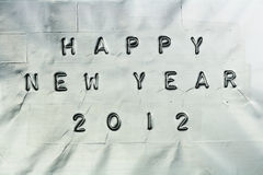 Happy New Year. Sign on a silver background Royalty Free Stock Photos