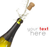 Happy new year. Bottle of champagne popping its cork and splashing stock photography