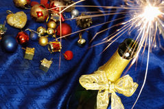 Happy New Year. Colorful christmas decoration with champagne on blue backgruond. close up Stock Images