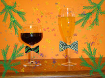 Happy new year. Two glasses of wine with confettis and streamers Royalty Free Stock Images