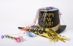 Happy New Year. Top hat with Happy New Year on it, next to party favors Royalty Free Stock Photography