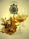 Happy New Year. Two glasses with champagne and bubbles. On a background is a clock Stock Photo