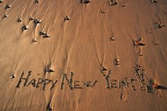 Happy New Year!. Happy New Year message on a beach Royalty Free Stock Photo