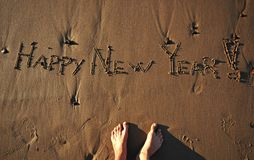 Happy New Year!. Happy New Year message on a beach Royalty Free Stock Photography